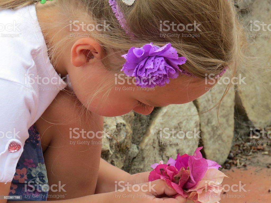 girl baby dreamer treats flower petals royalty-free stock photo