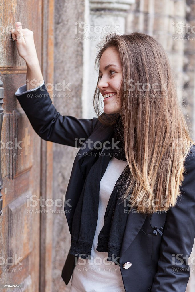 Girl bangs in a closed door stock photo