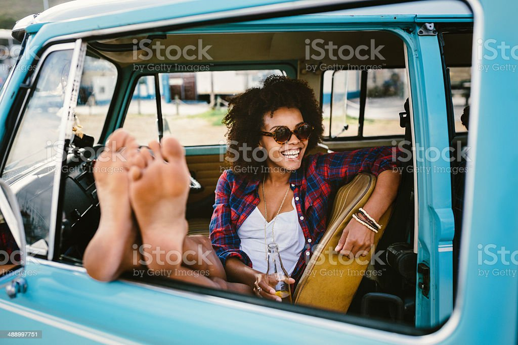 Girl barefoot in the car stock photo
