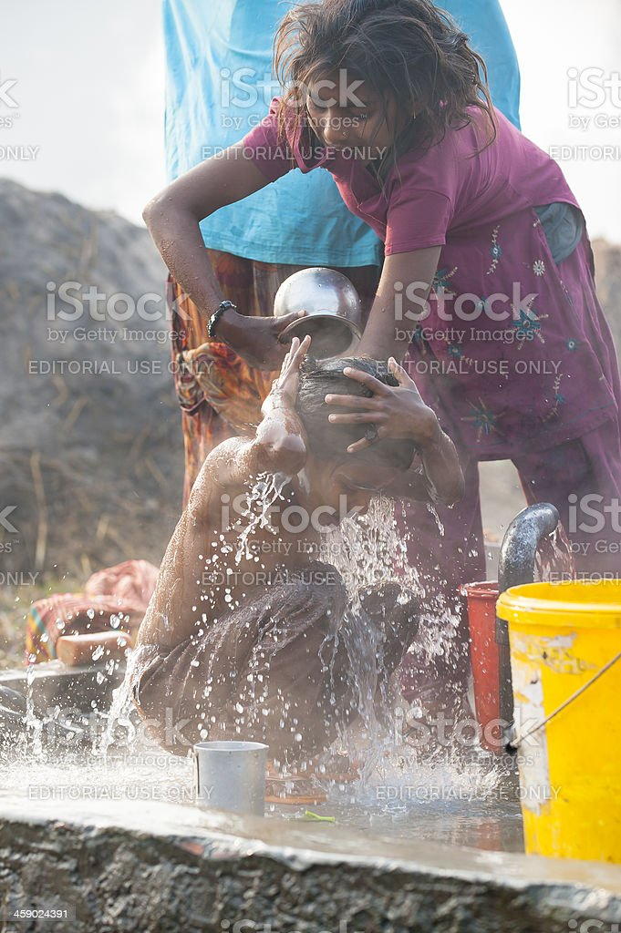 Girl bathing at well in village close to Janakpur, Nepal stock photo