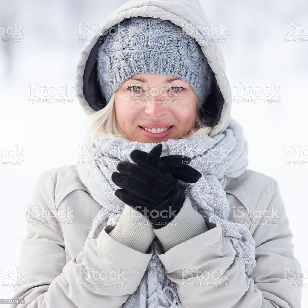 Girl beeing cold outdoors in winter. stock photo