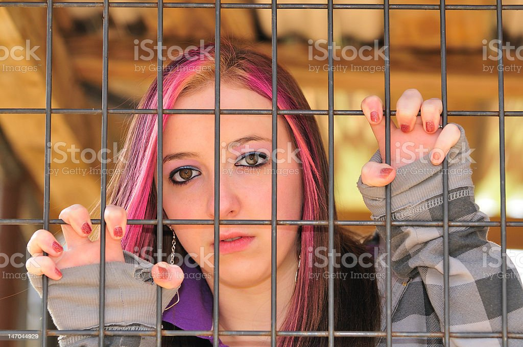 girl behind bar stock photo