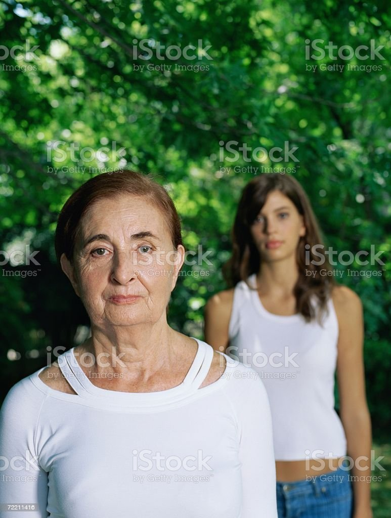 Girl behind grandmother royalty-free stock photo
