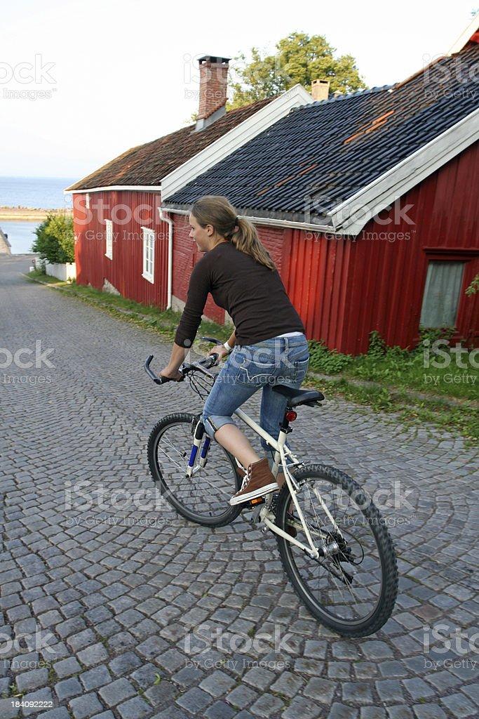 Girl Biking in Åsgårdstrand, Norway royalty-free stock photo