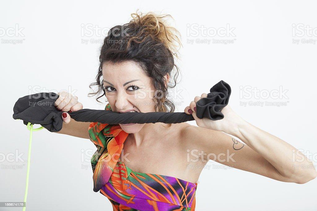 Girl biting a cloth stock photo