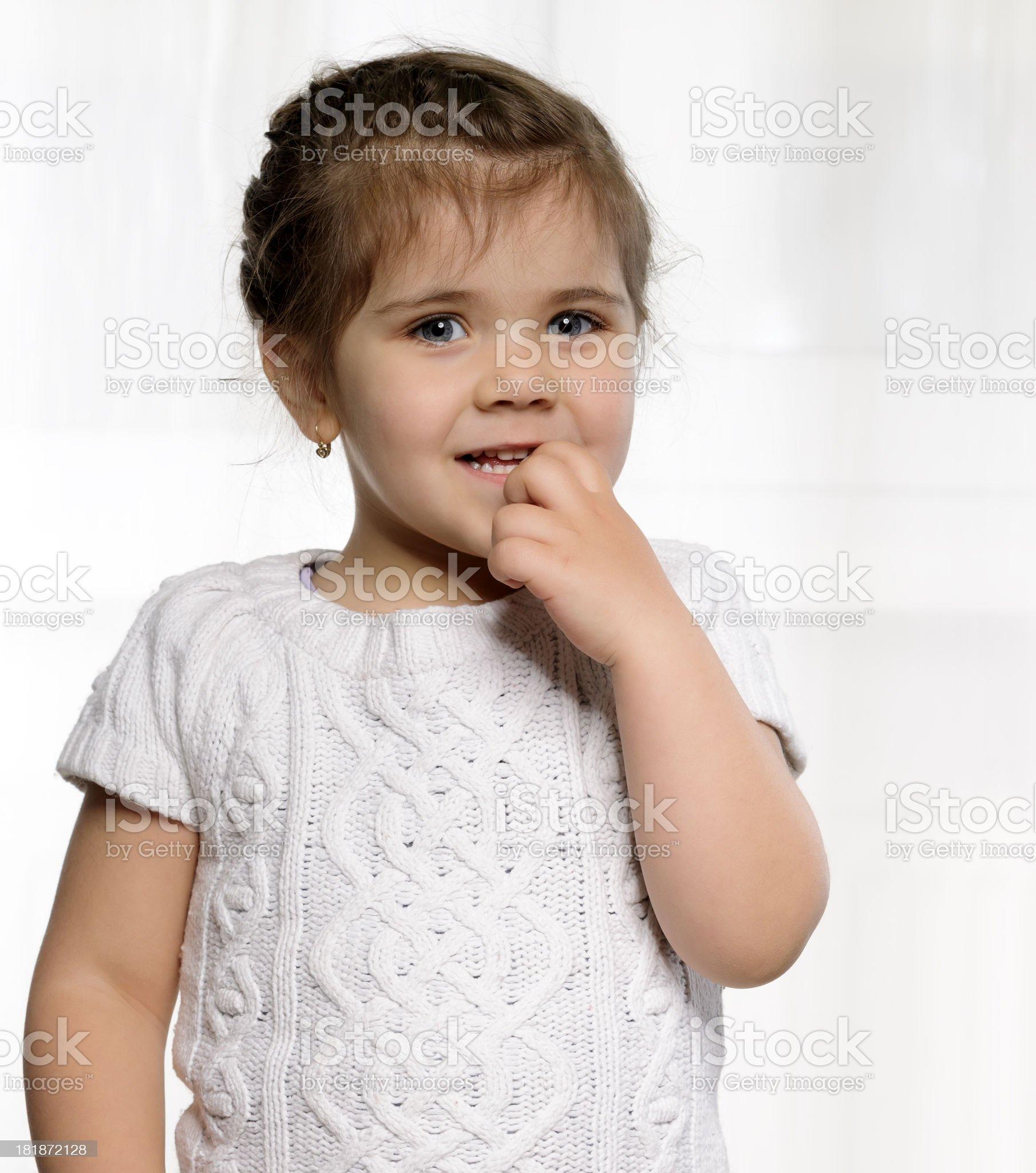 girl biting finger royalty-free stock photo