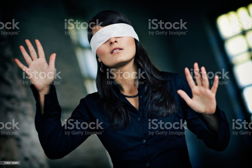 Girl blindfolded goes by feel stock photo