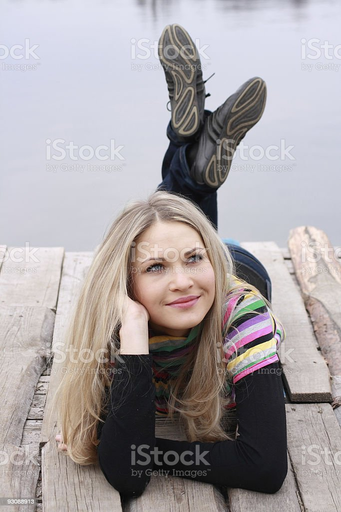 girl blonde near lake stock photo