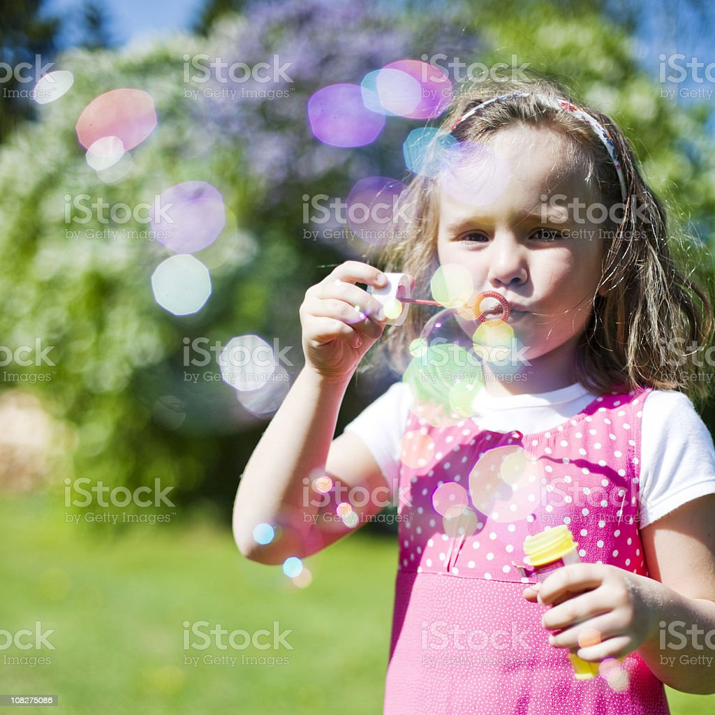 Girl Blowing Bubbles royalty-free stock photo