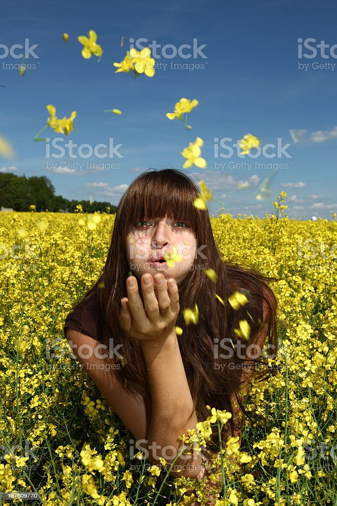 Girl blowing flowers royalty-free stock photo