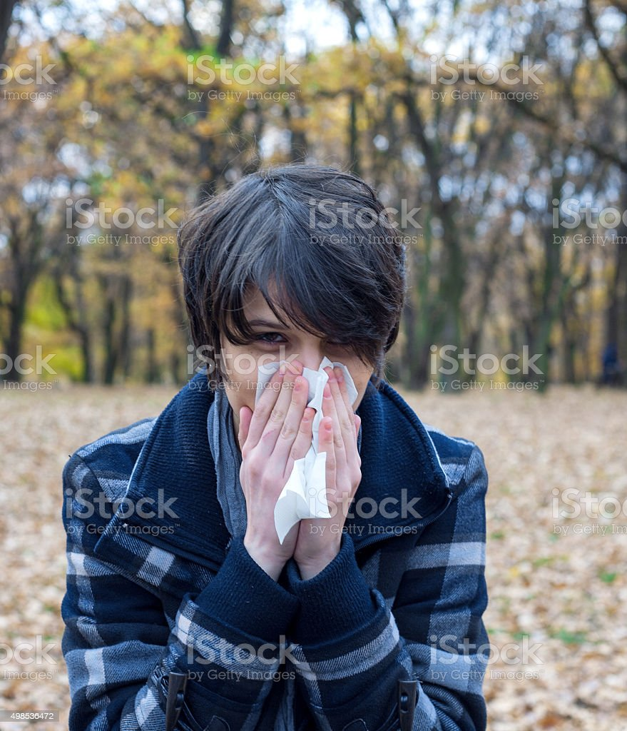 Girl blowing her nose royalty-free stock photo