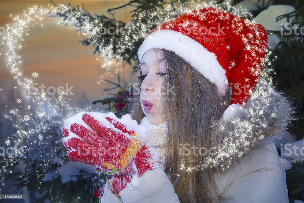 Girl blowing on snow royalty-free stock photo