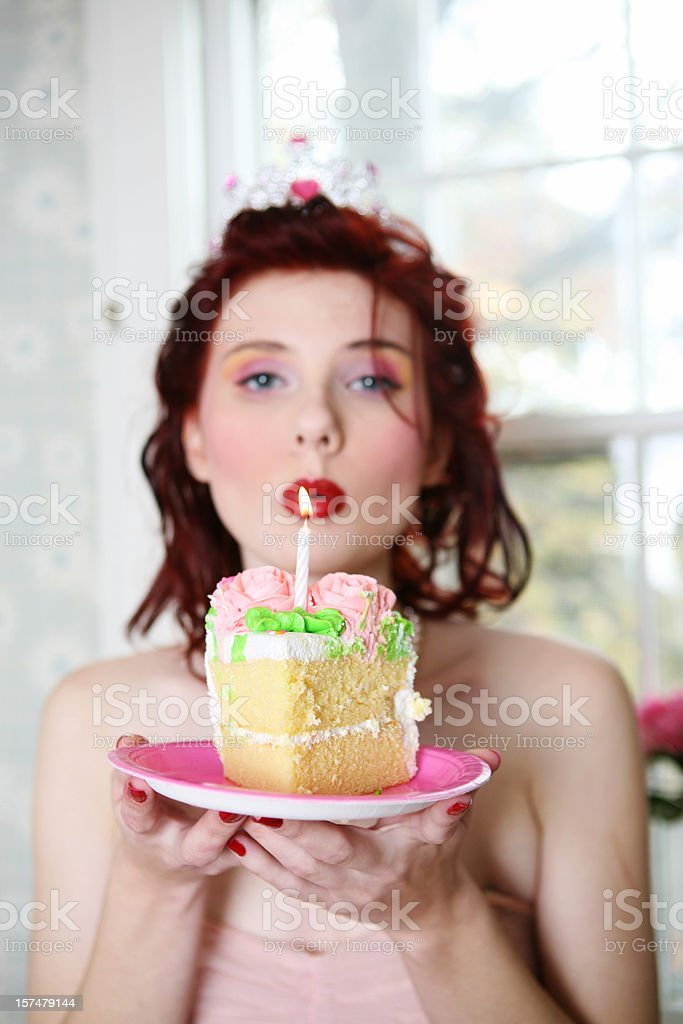 girl blowing out candles royalty-free stock photo