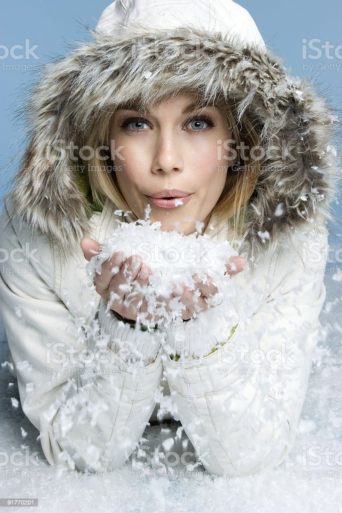 Girl blowing snow stock photo