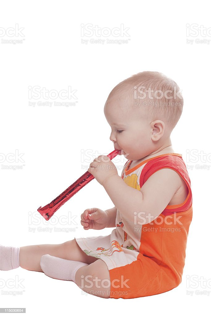 Girl blowing to horn stock photo