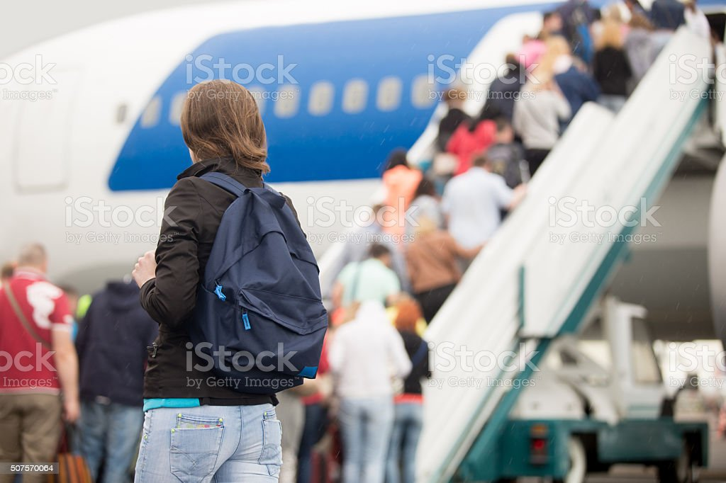 Girl boarding plane, back view stock photo