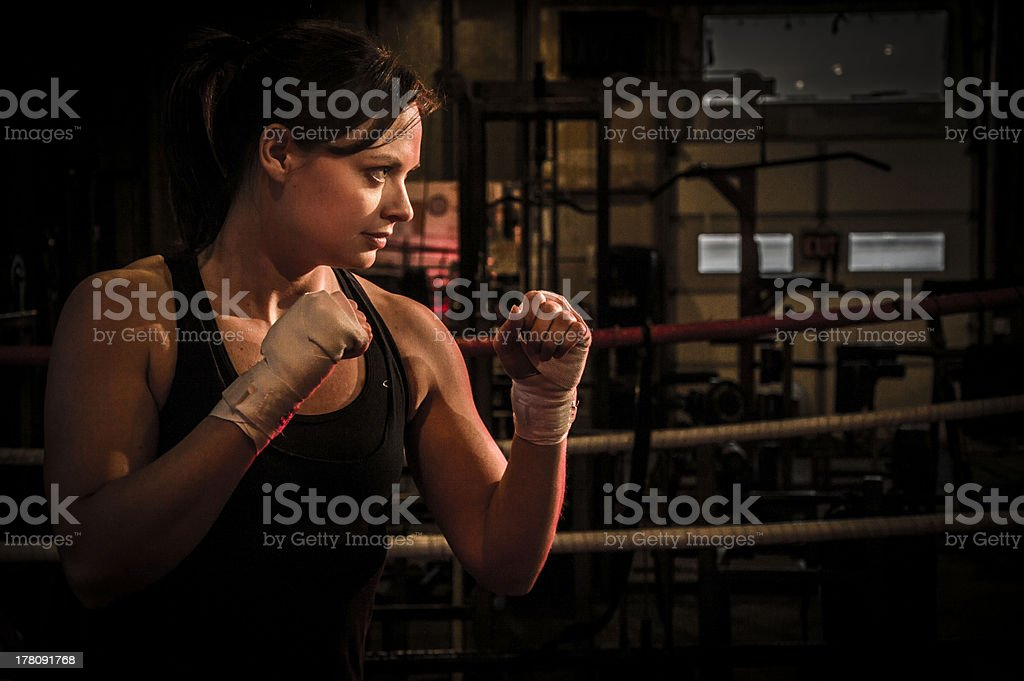 Girl Boxer in Fighting Stance stock photo