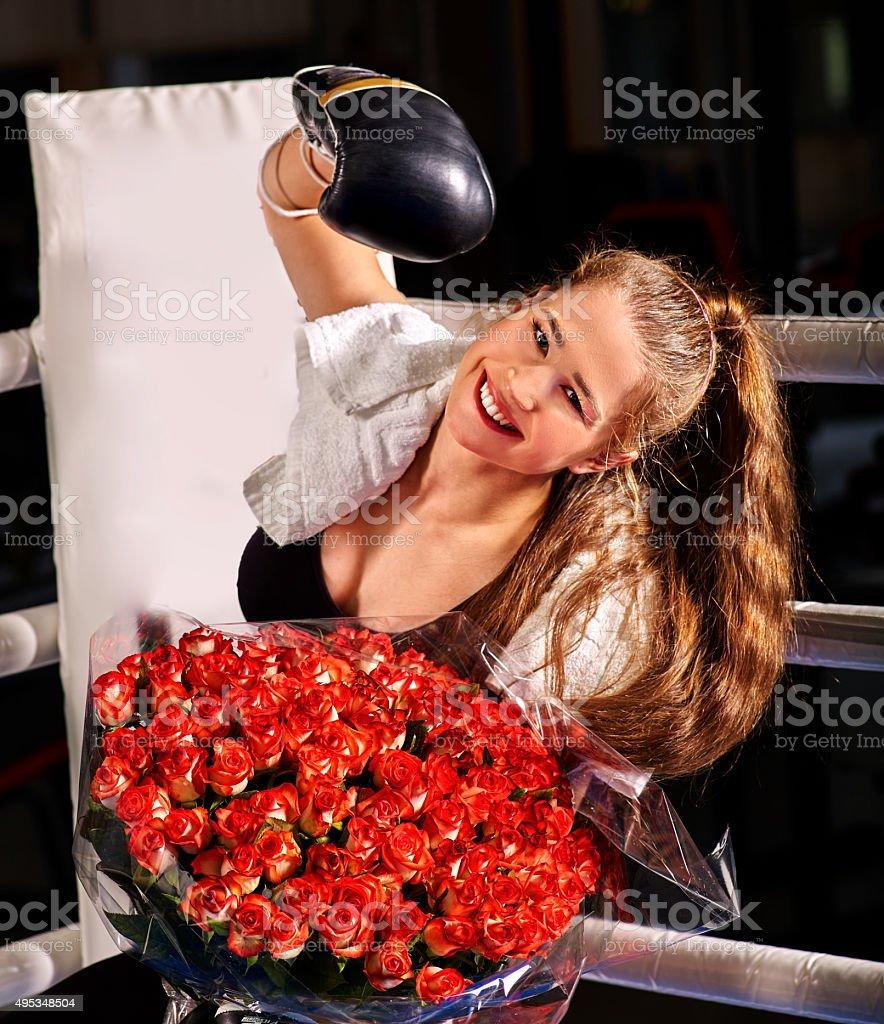Girl  boxing sitting in corner of ring stock photo