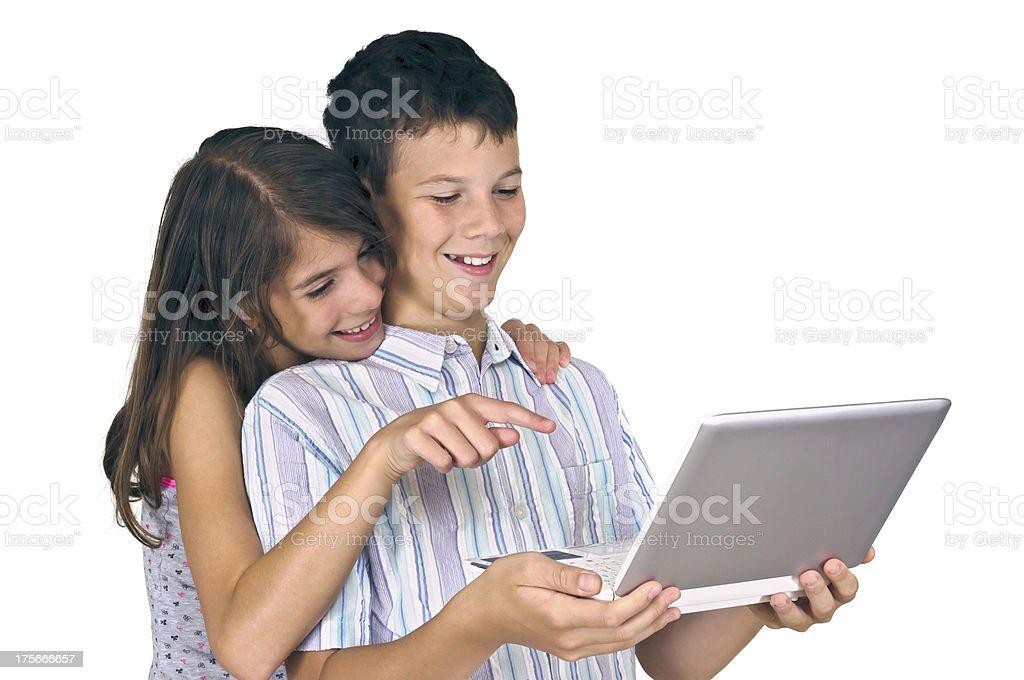 Girl & boy looking laptop royalty-free stock photo