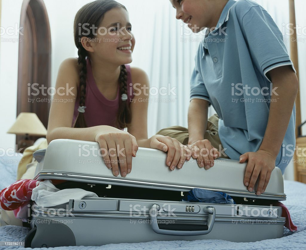 Girl & Boy packing royalty-free stock photo