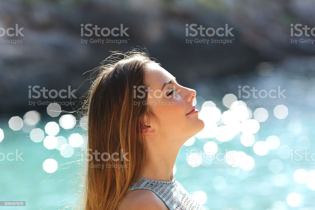 Girl breathing fresh air on a tropical beach on holidays stock photo