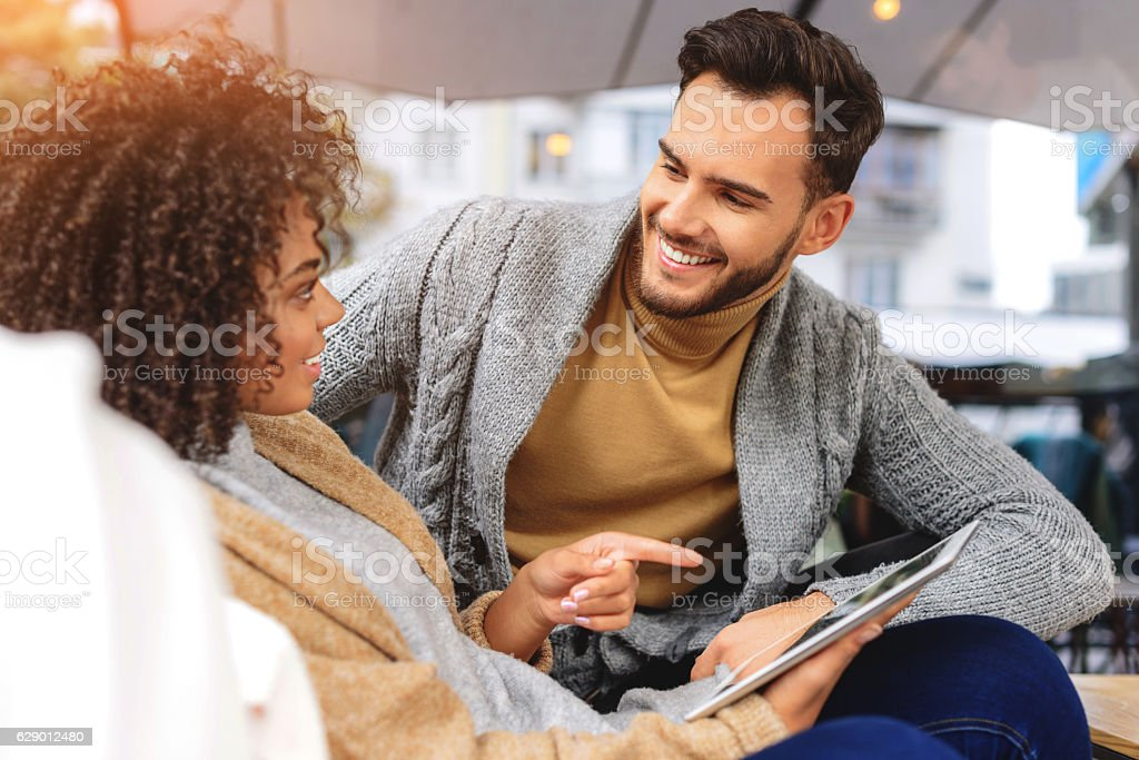 girl browsing the internet with her boyfriend stock photo