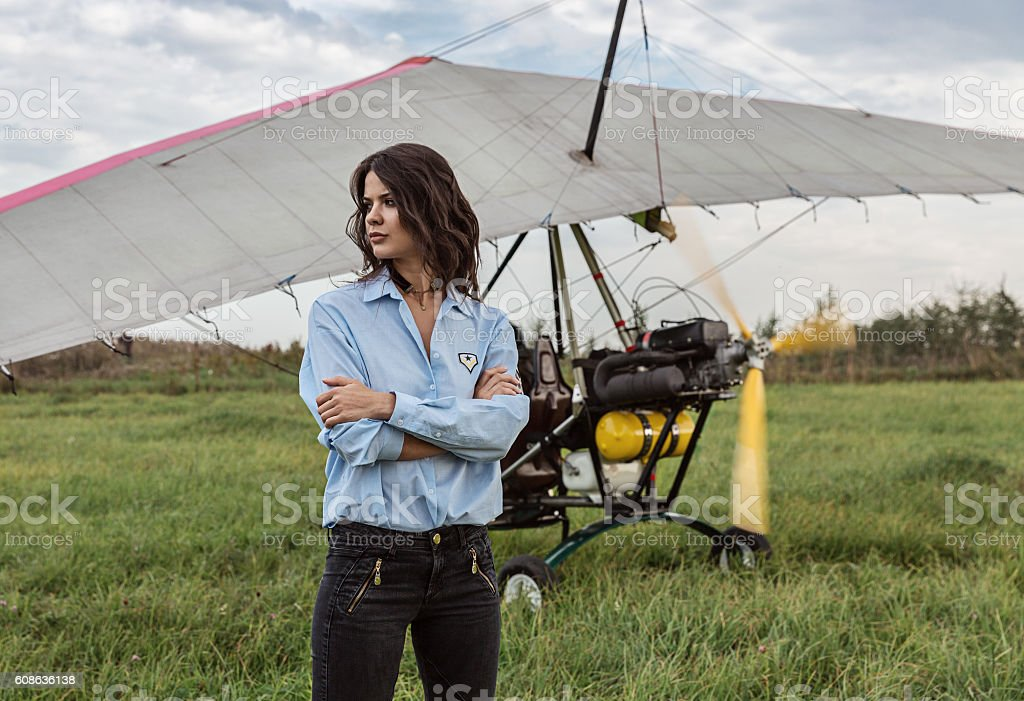 Girl brunette and a hang glider. stock photo