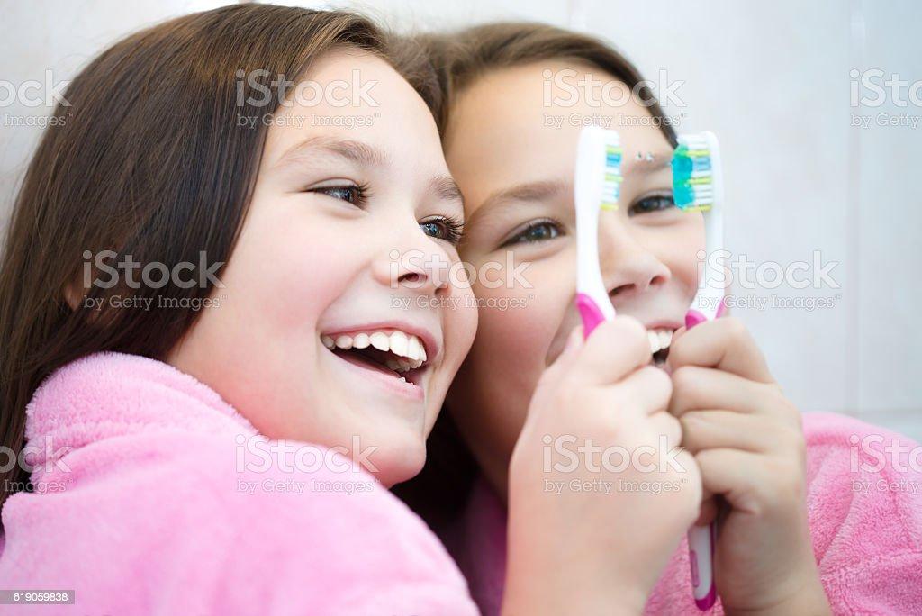 Girl brushes her teeth stock photo