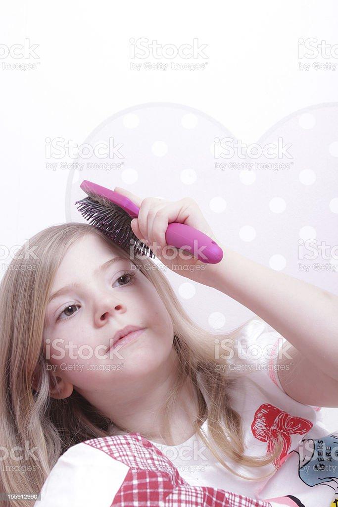 Girl brushing her hair royalty-free stock photo
