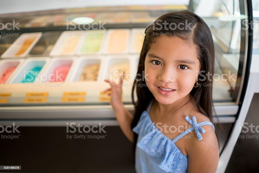 Girl buying an ice cream stock photo