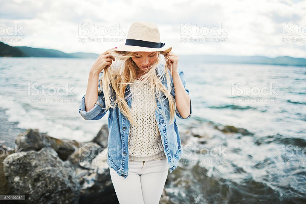 Girl by the seaside stock photo