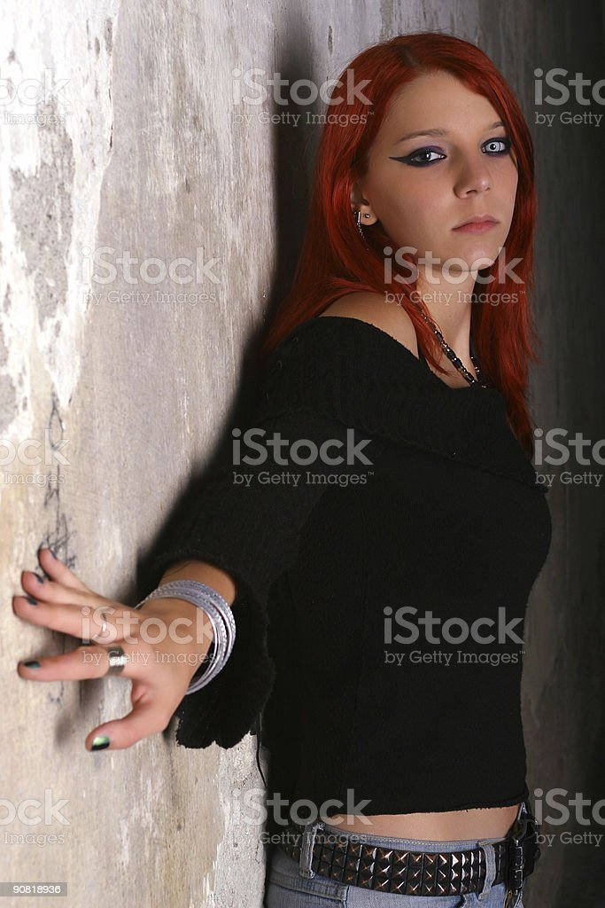 Girl by the wall royalty-free stock photo