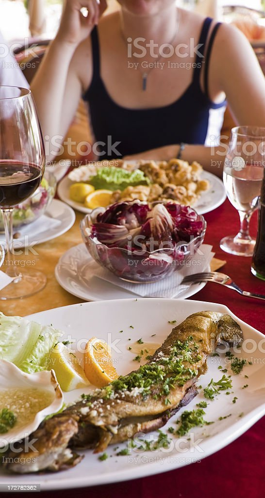 Girl, calamari and fish royalty-free stock photo