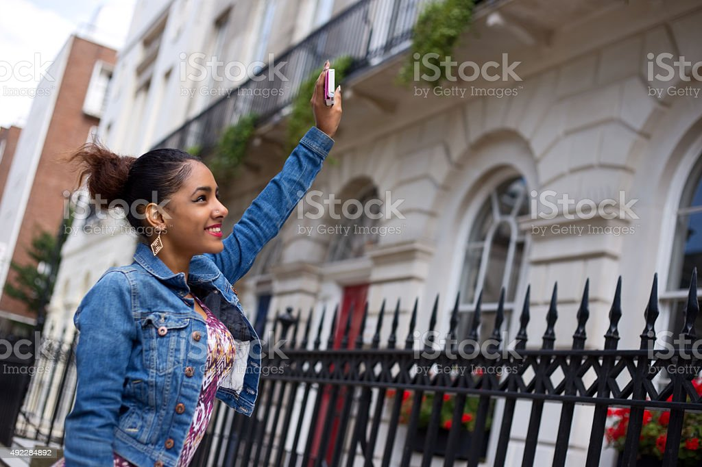 girl calling to friends window royalty-free stock photo