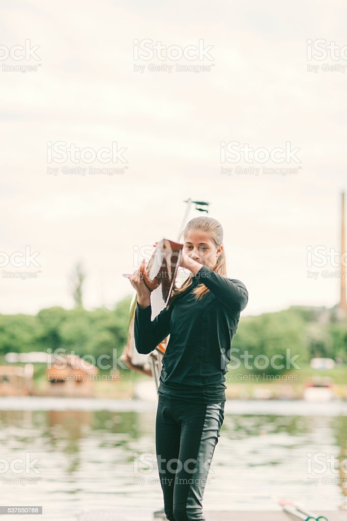 Girl Carry Single Scull With Her Instructor. stock photo