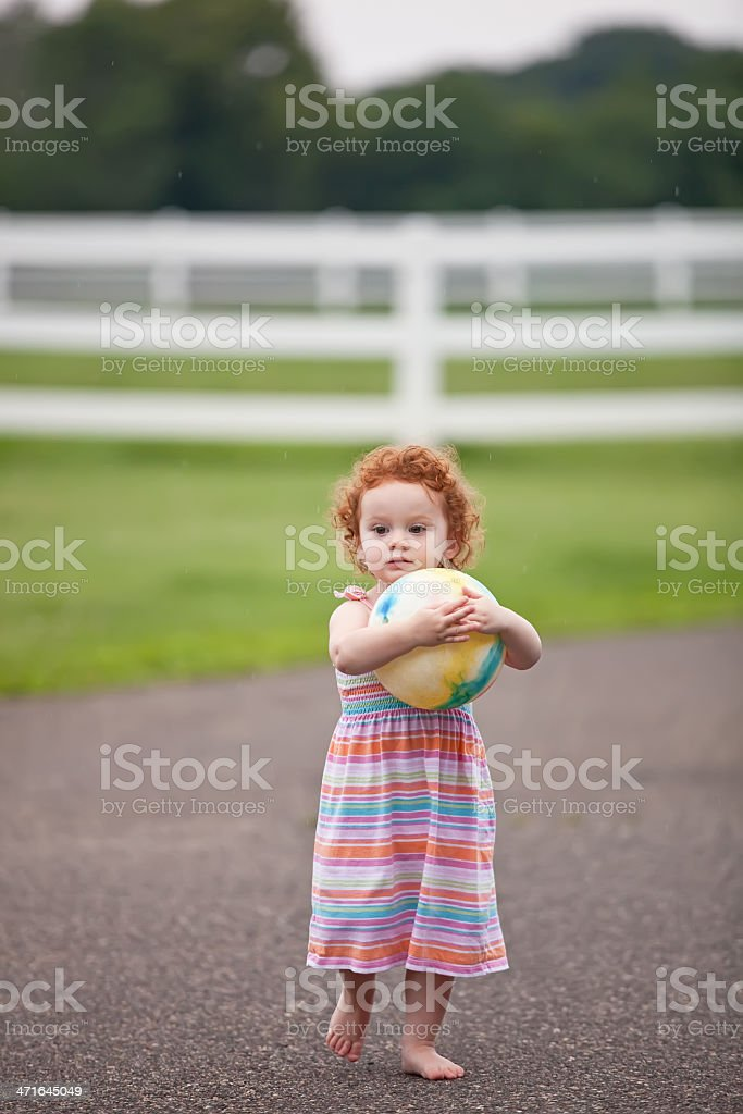 Girl Carrying Ball royalty-free stock photo