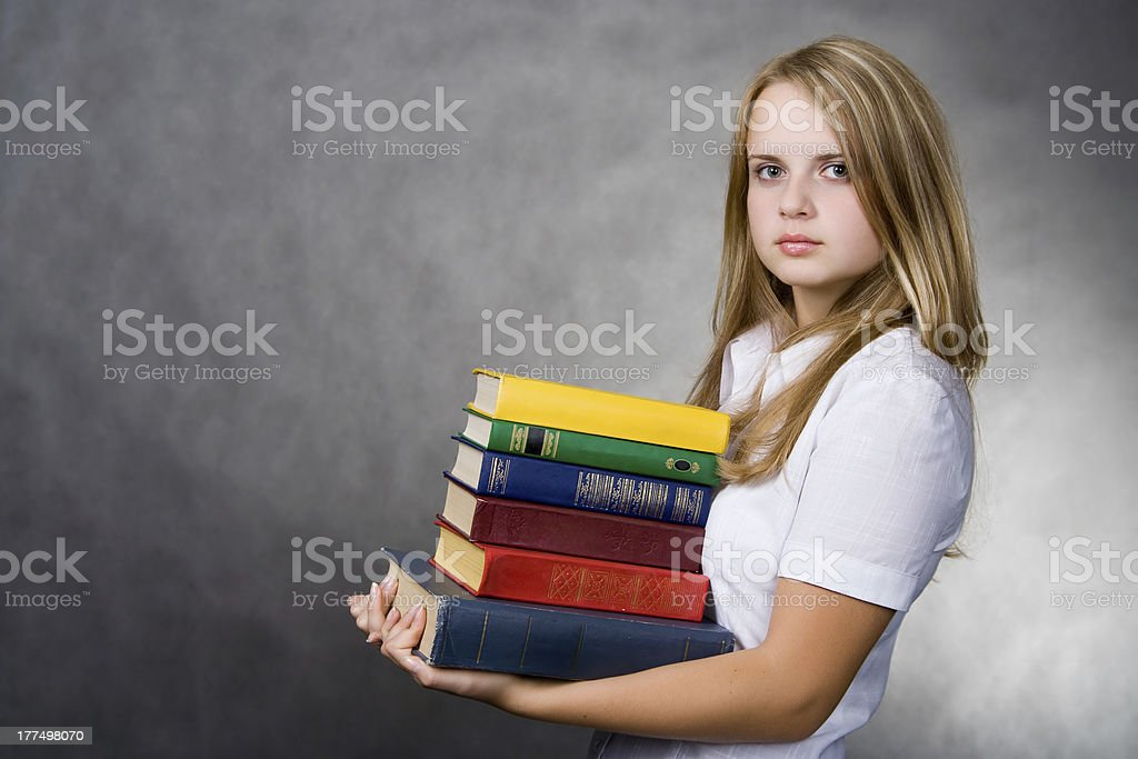 Girl carrying books royalty-free stock photo