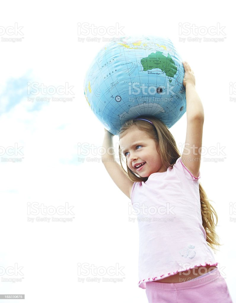 Girl carrying globe on her head royalty-free stock photo