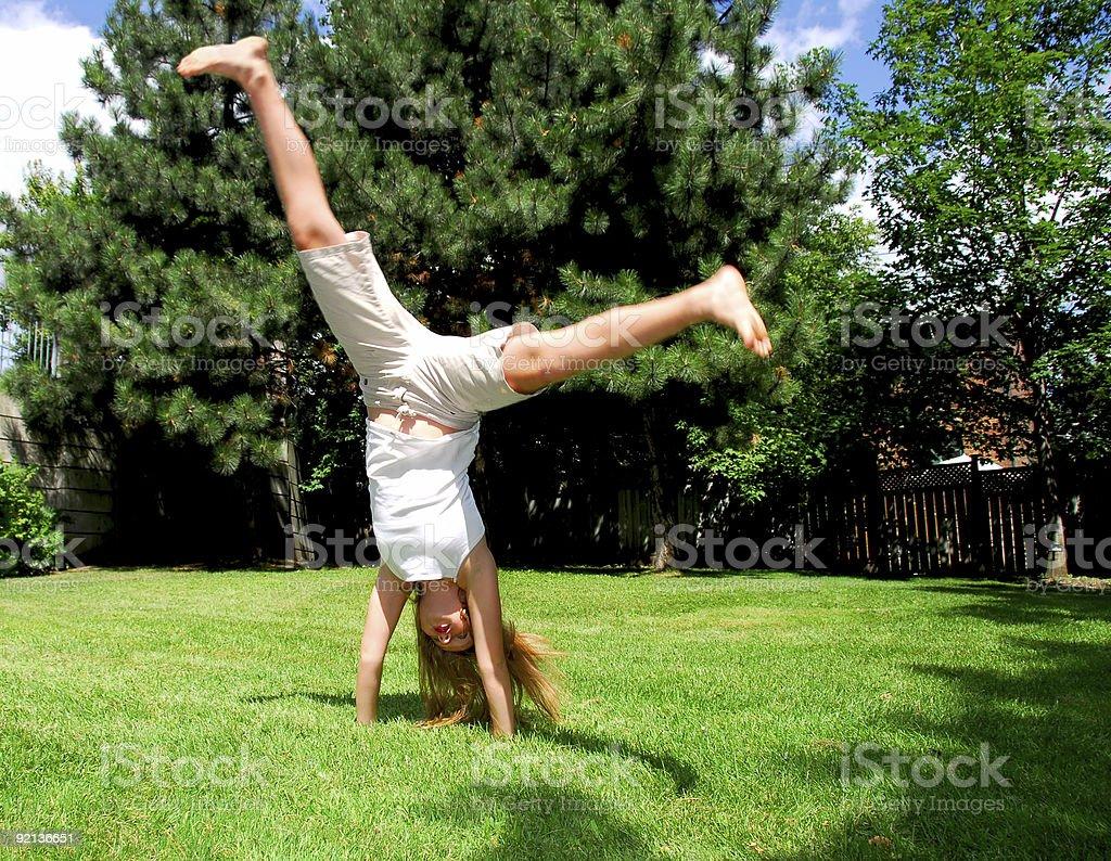 Girl cartwheel stock photo