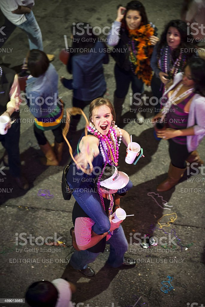 Girl catching beads at Mardi Gras royalty-free stock photo