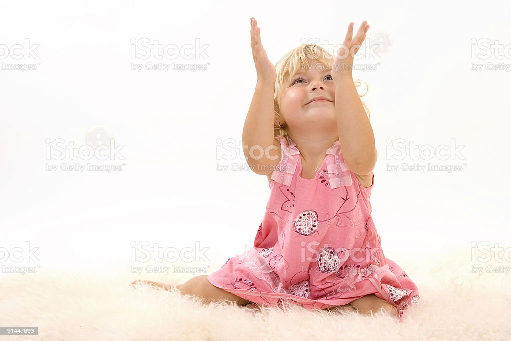 girl catching bubbles royalty-free stock photo