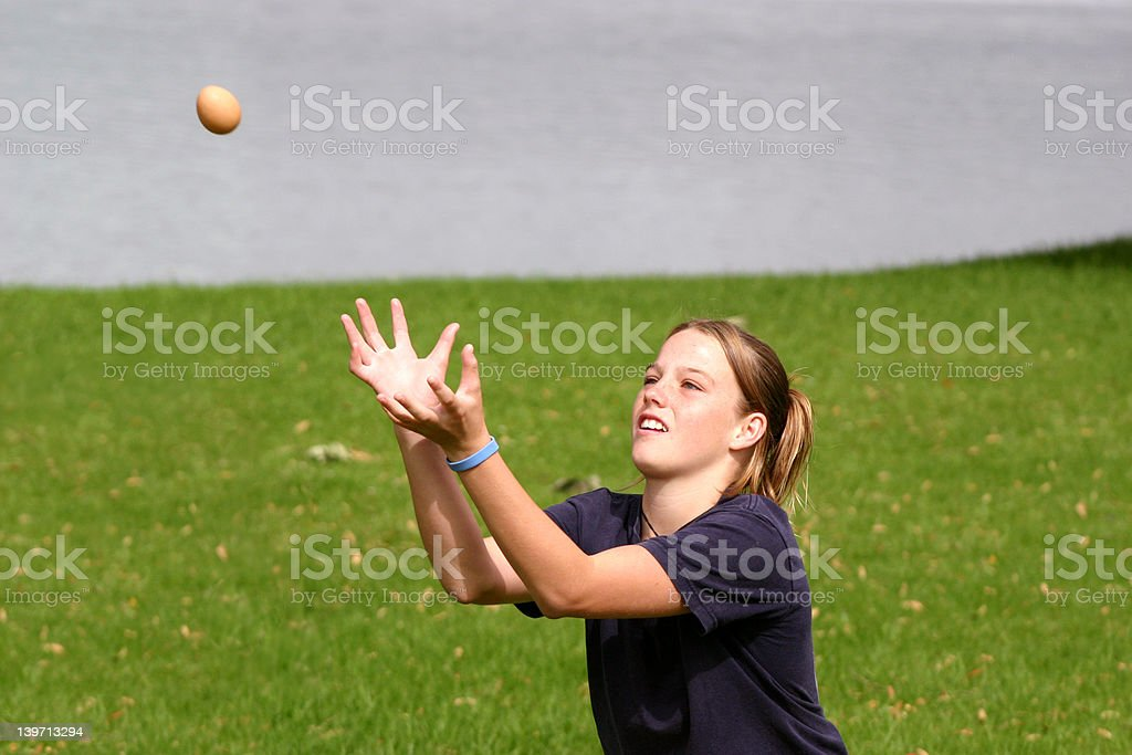 Girl catching egg stock photo