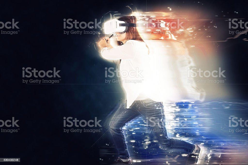 Girl chasing someone in VR stock photo