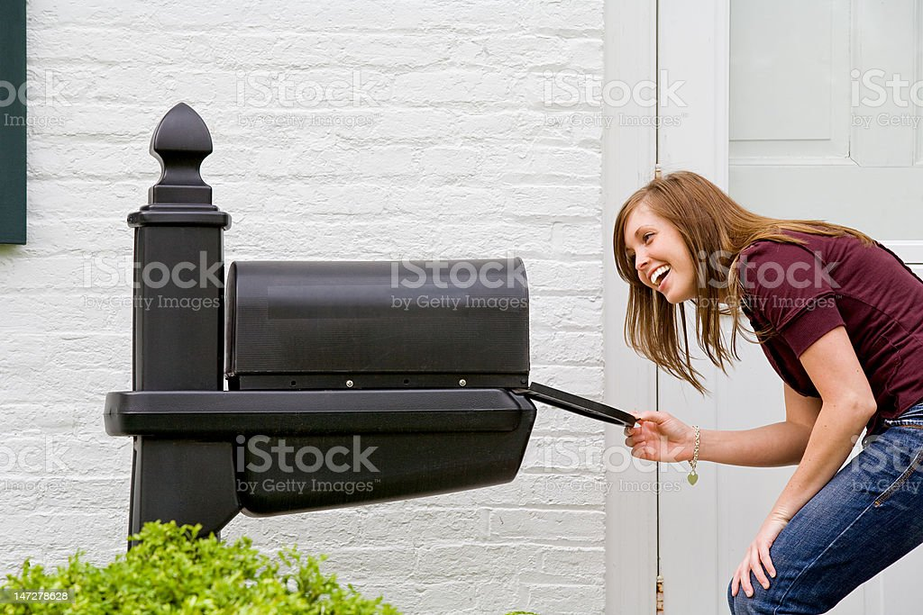 Girl Checking for Mail stock photo