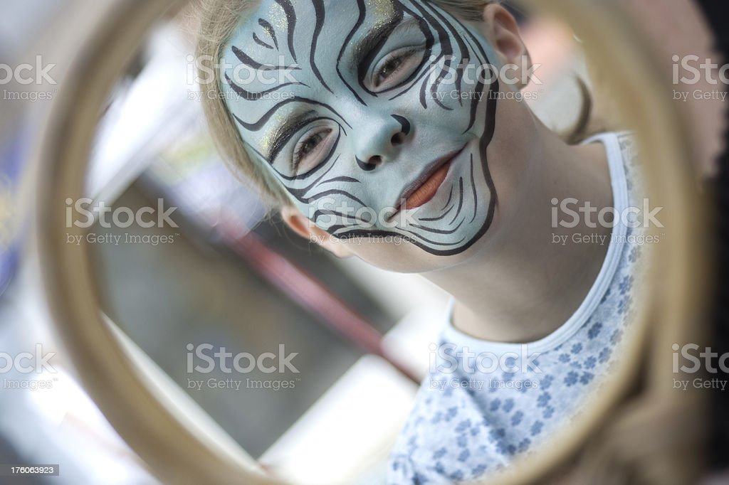 Girl Checking Out Her Face Paint royalty-free stock photo