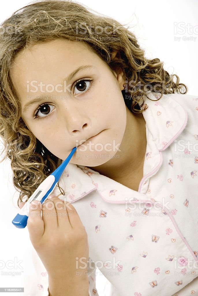 Girl cheking her temparature with a thermometer. stock photo