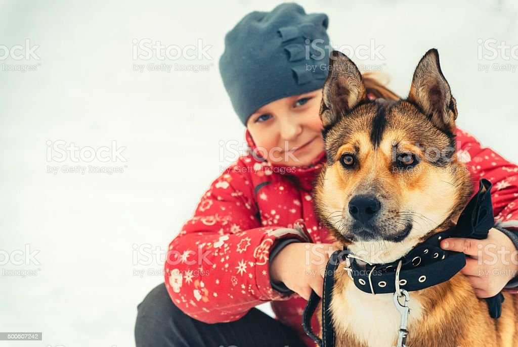 Girl Child and Dog hugging and playing Outdoor Lifestyle stock photo