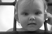 girl child behind bars