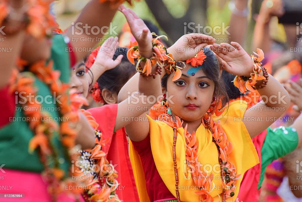 Girl child dancers perforimg at Holi (Spring) festival in Kolkata. stock photo