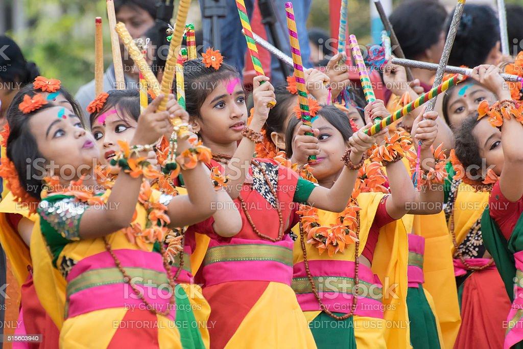 Girl child dancers perforimg at Holi (Spring) festival in Kolkata. stock photo